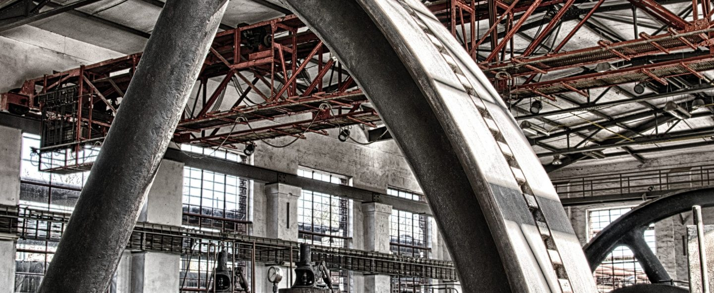 industrial shot of a large metal wheel in a factory