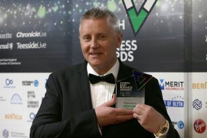 Universal Wolf Managing Director Patrick Macdonald holding trophy at North East Business Awards 2019