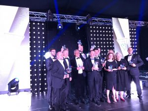 All winners at the NEBA 2019 Grand Final standing on stage with their awards