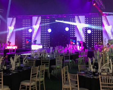 North East Business Awards 2019 ceremony room with table decorations and a stage in the background