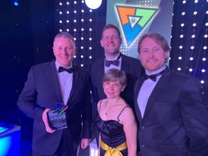 4 Universal Wolf employees in evening dress with their Manufacturing Award at the North East Business Awards Grand Final 2019