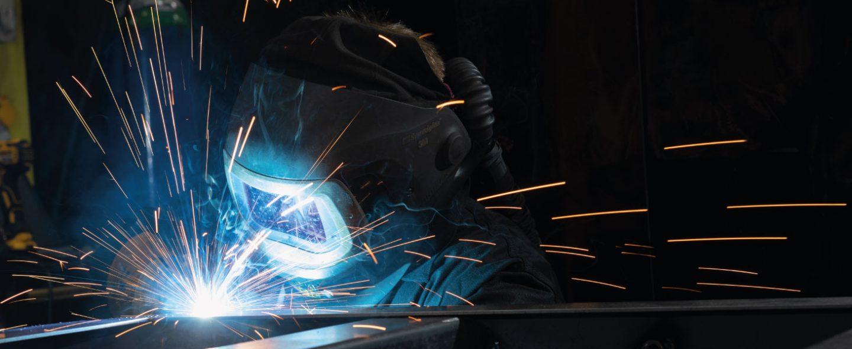 a welder working on a piece of metal