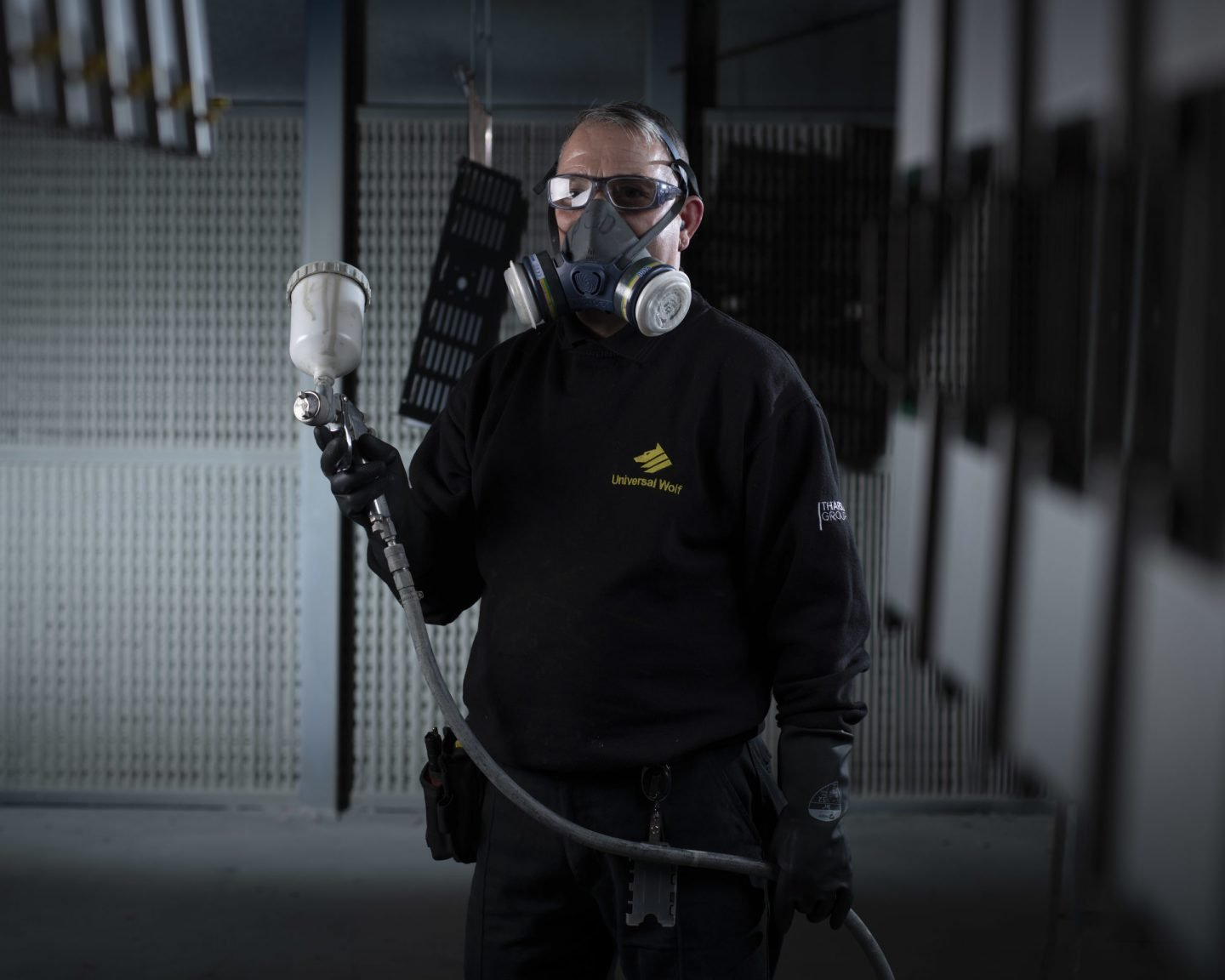 Metal painting technician in spray booth