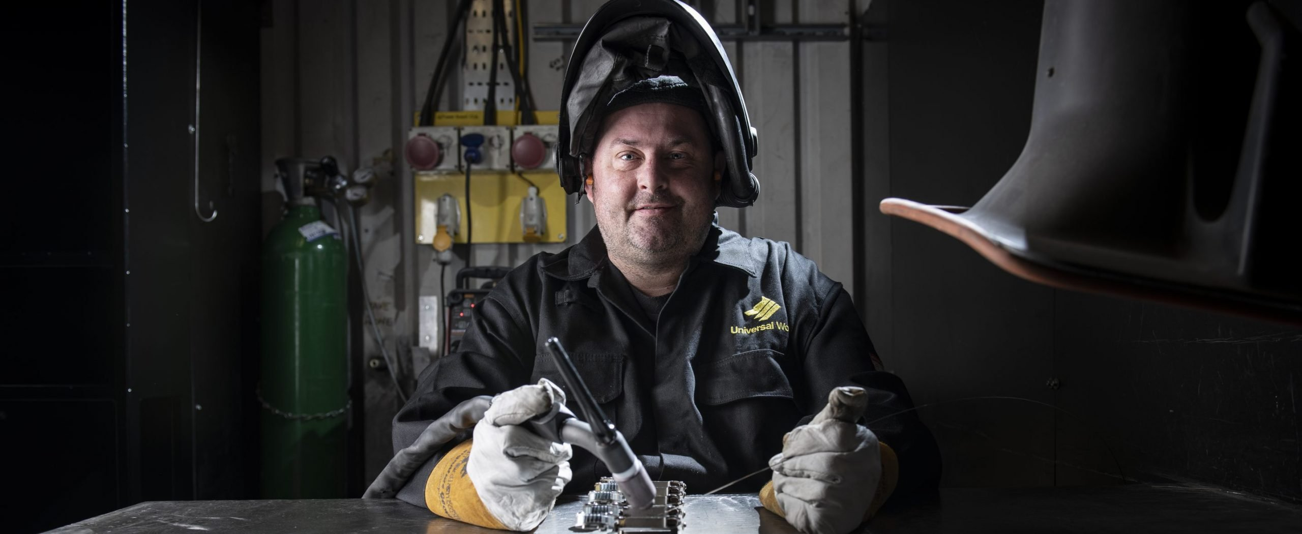 A welder working in Universal Wolf's sheet metal welding and fabrication service