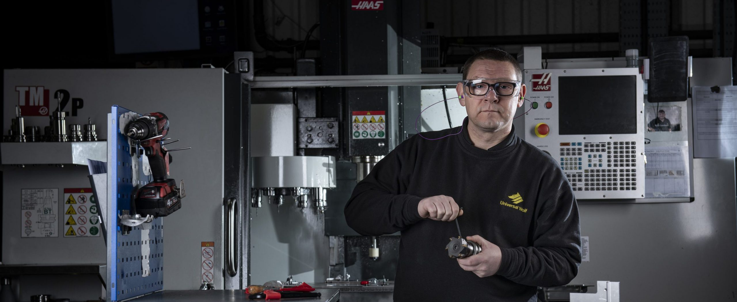 An engineer working in Universal Wolf's CNC Machining Service