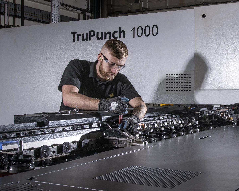 An engineer working in Universal Wolf's metal profiling department