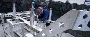 Engineer working on SMD ROV aluminium fabricated chassis